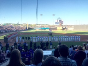 Teams line up for Saints Opening Day and inaugural game at CHS Field.