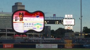"The guitar-shaped scoreboard/video board and guitar-pick shaped signage honor ""Music City."""